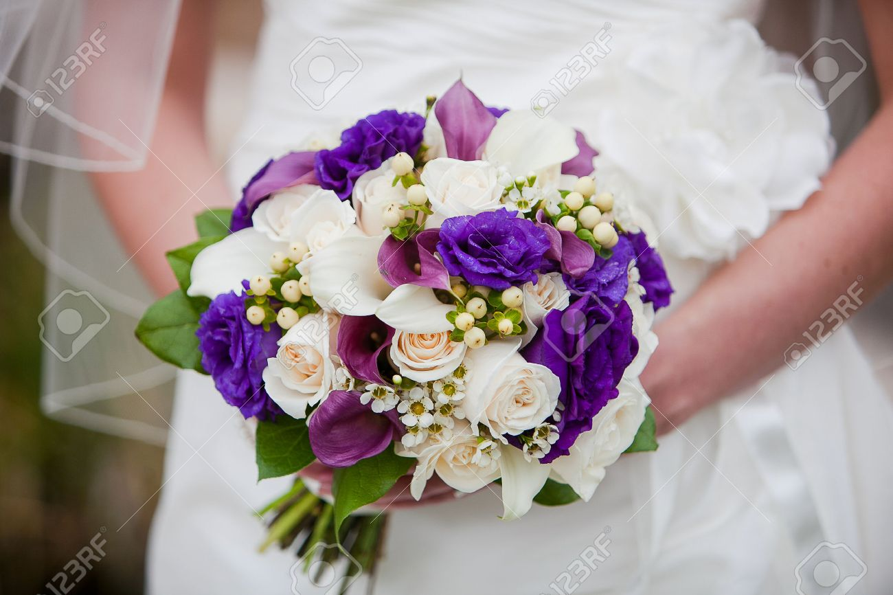 Bride Holding Wedding Bouquet Consisting Of White Calla Lilies Purple Off