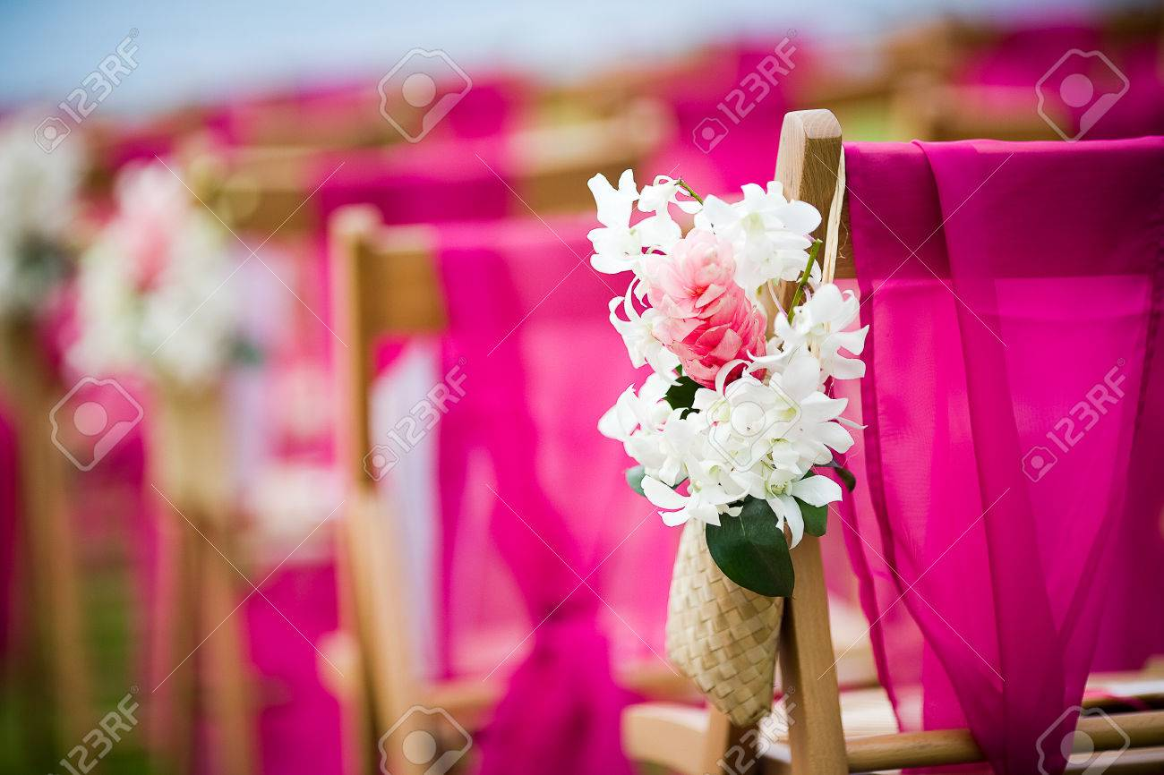 White Dendrobium Orchid And Pink Ginger Flowers On A Wedding Aisle