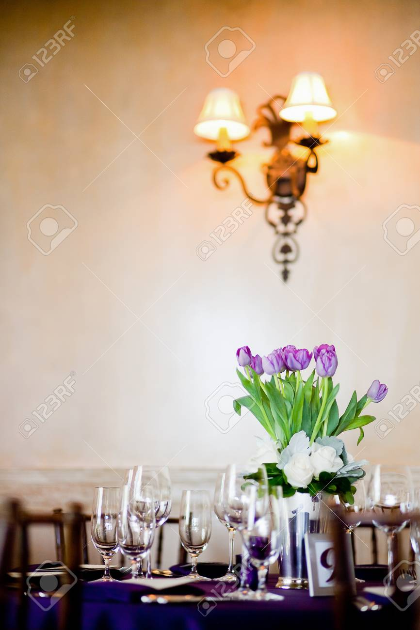 Admirable Purple Tulips Centerpiece At A Formal Dinner Download Free Architecture Designs Intelgarnamadebymaigaardcom