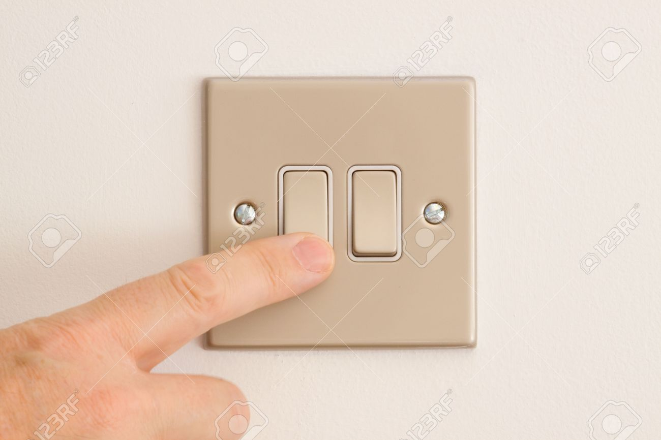 British Double Lightswitch on a White Wall in off position about to be pressed Stock Photo - 5374325