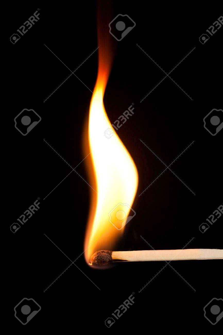 Match bursting into flame against a black background Stock Photo - 6032447