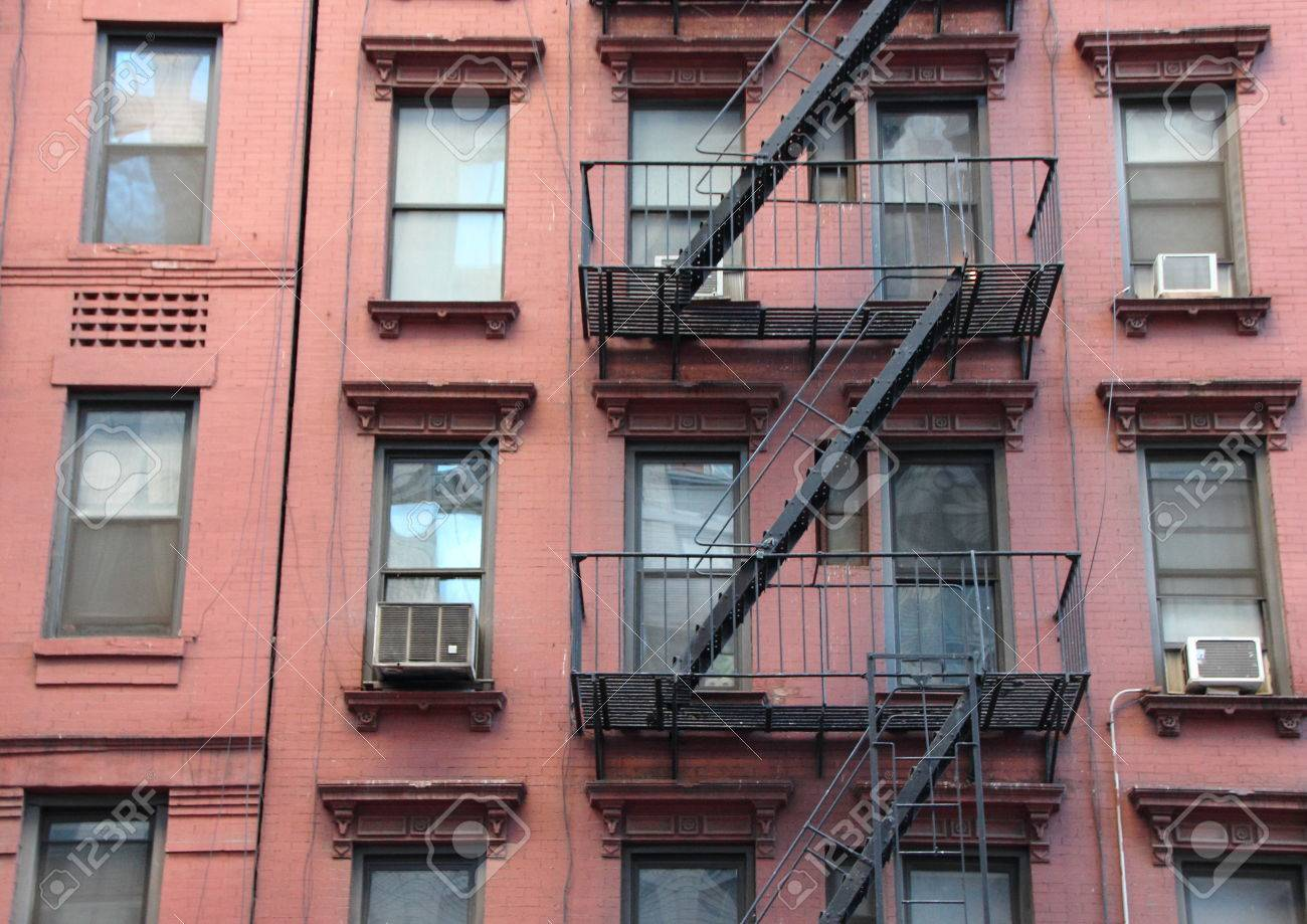 Apartment Building Fire Escape Ladder fire escape steel ladder on urban red apartment house facade