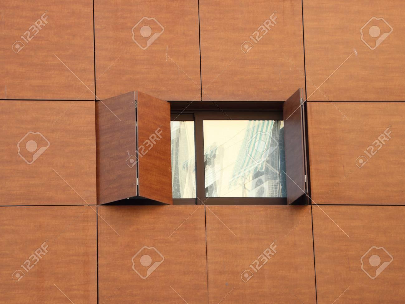 Single Window With Folded Open Wooden Shutter
