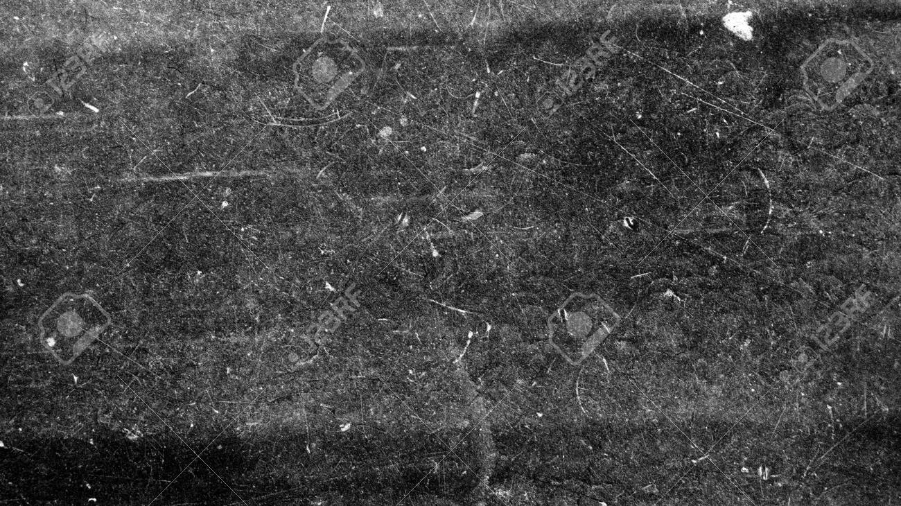 Texture Of Old Film On Black Background And White Scratches