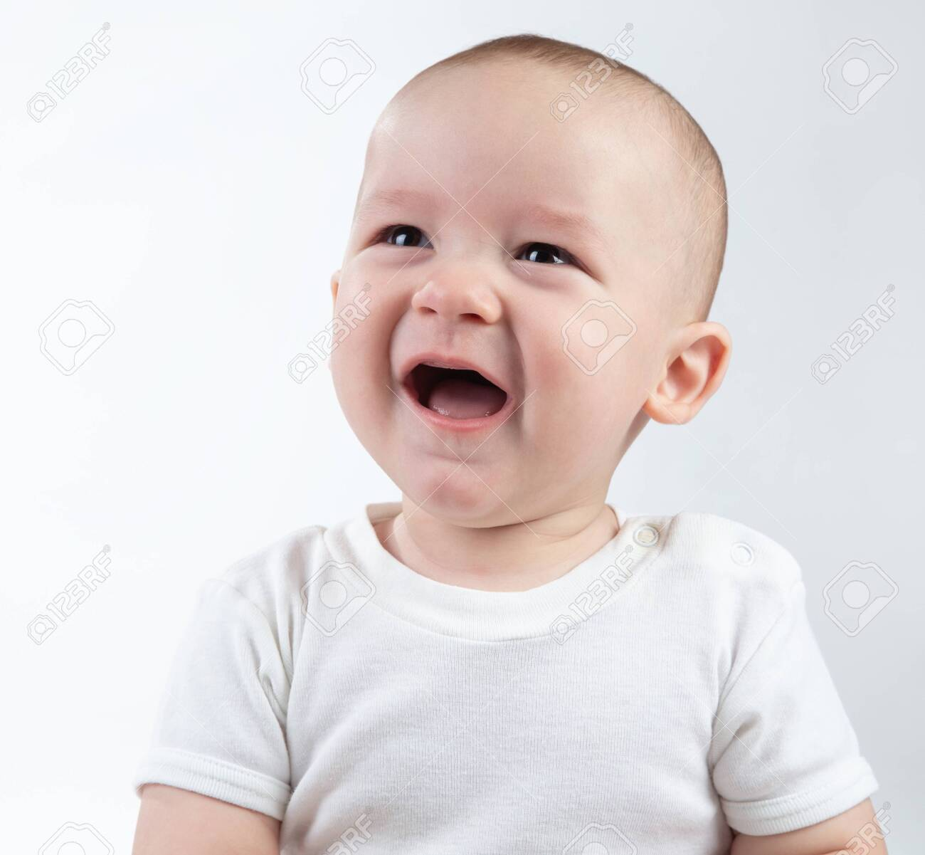 Portrait of unhappy nine-month-old baby on a white background - 152476856