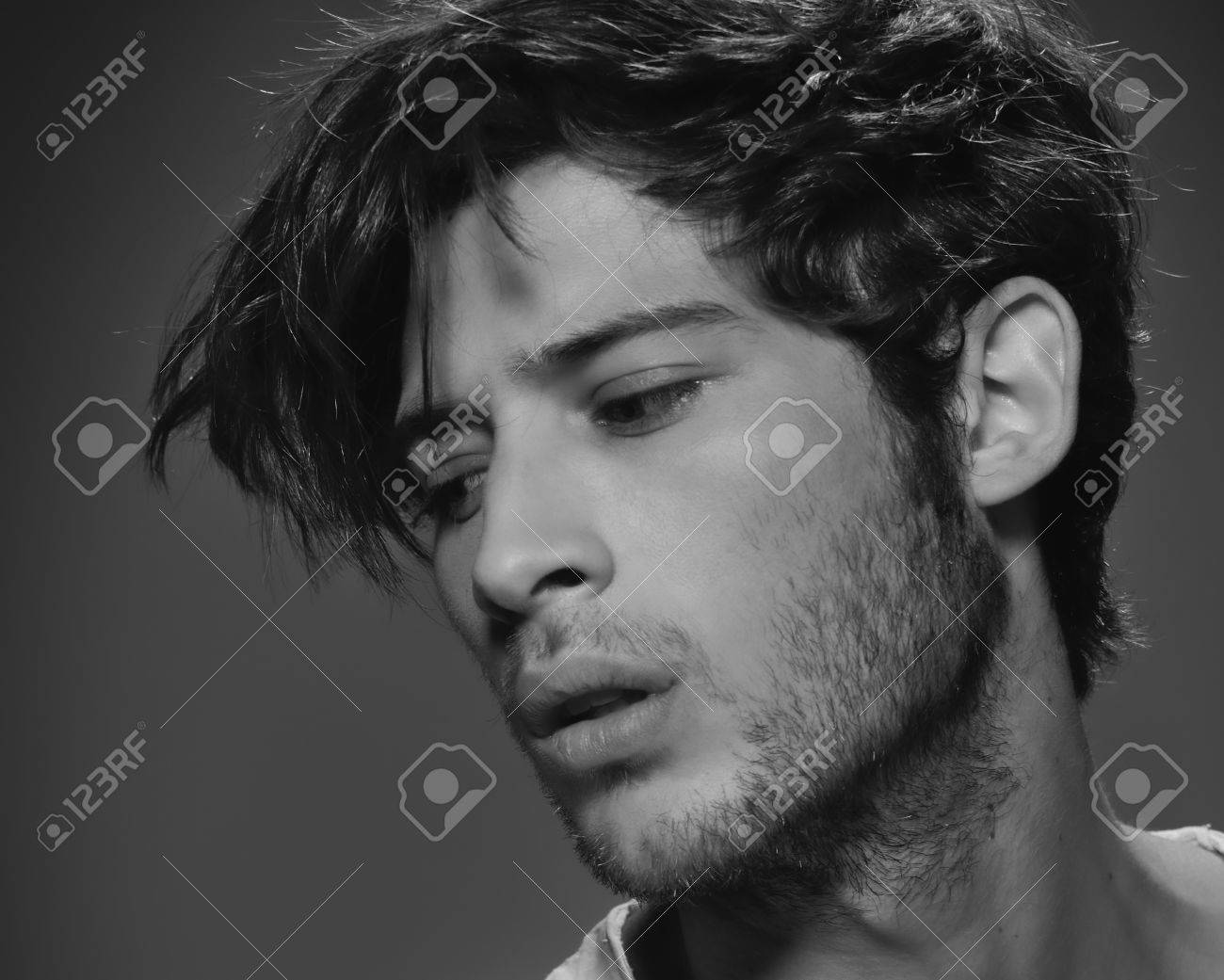 Portrait of a young beautiful male model in black and white stock photo 44484724