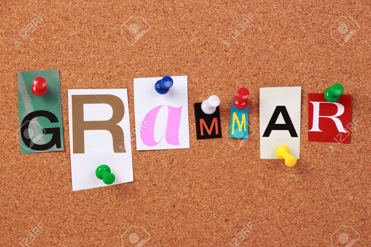 stock photo the word grammar in cut out magazine letters pinned to a corkboard