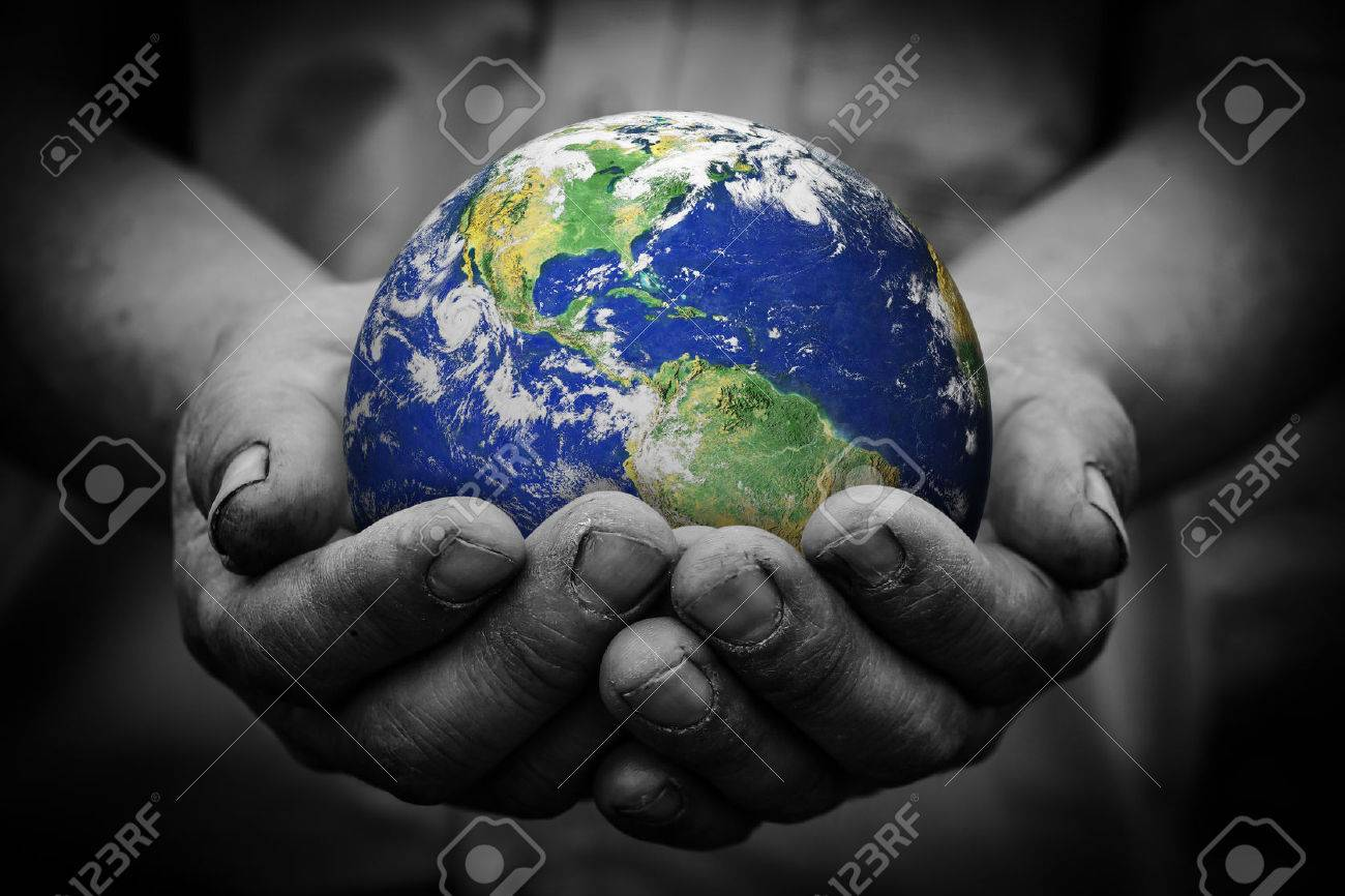 Man holding an earth globe in his hands. - 42903361