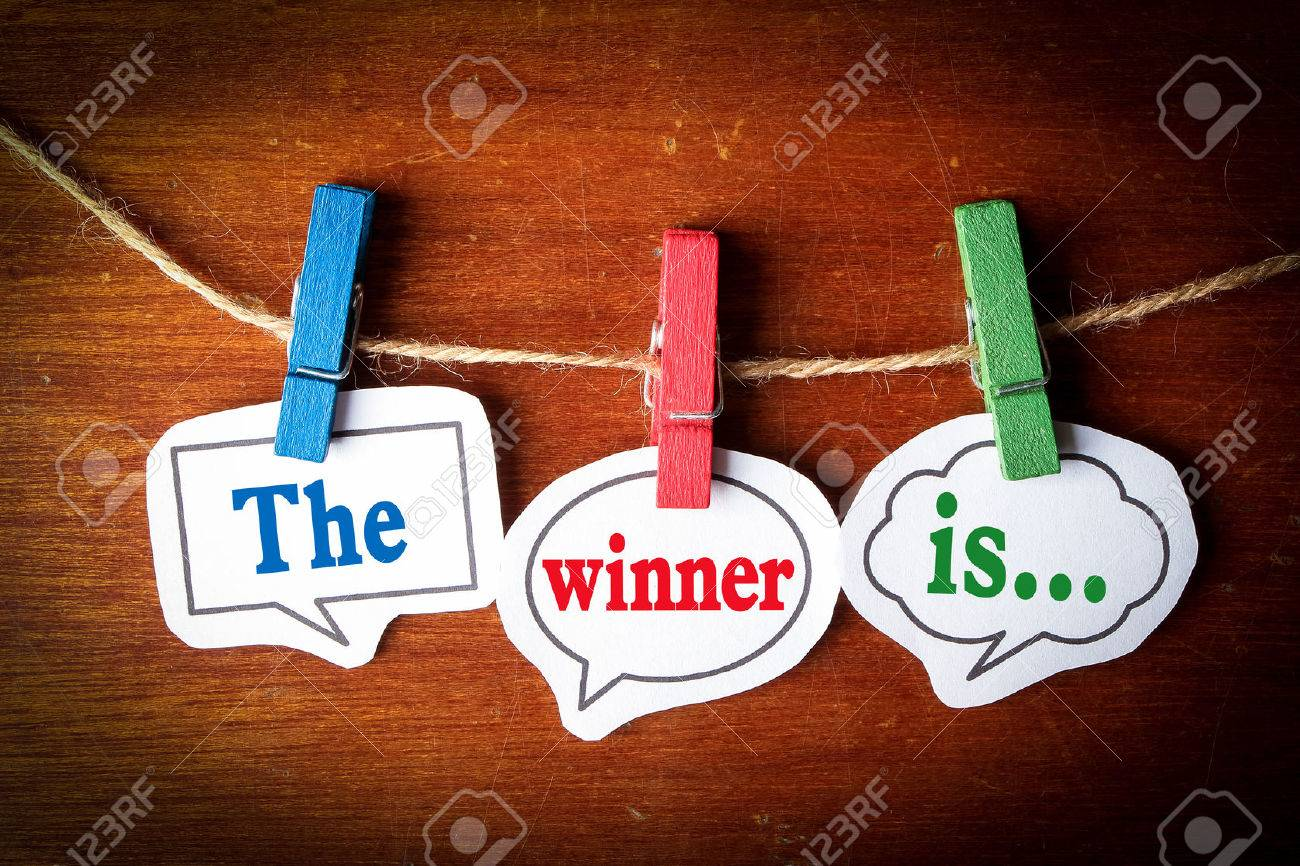 The winner is concept paper speech bubbles with line on the wooden background. - 44378377