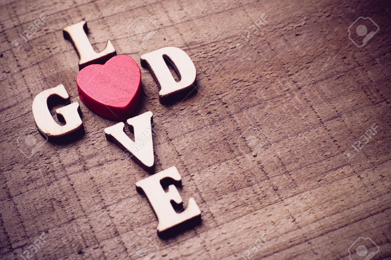 God Is Love Concept Text Lying On The Rustic Wooden Background Stock Photo