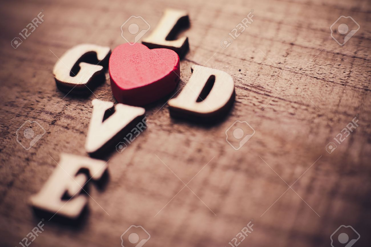 God is love concept text lying on the rustic wooden background. - 46602455