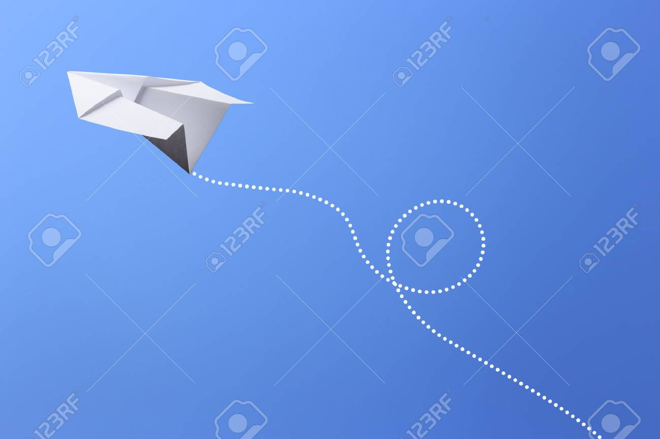 Paper plane flying in the blue sky. - 46929606