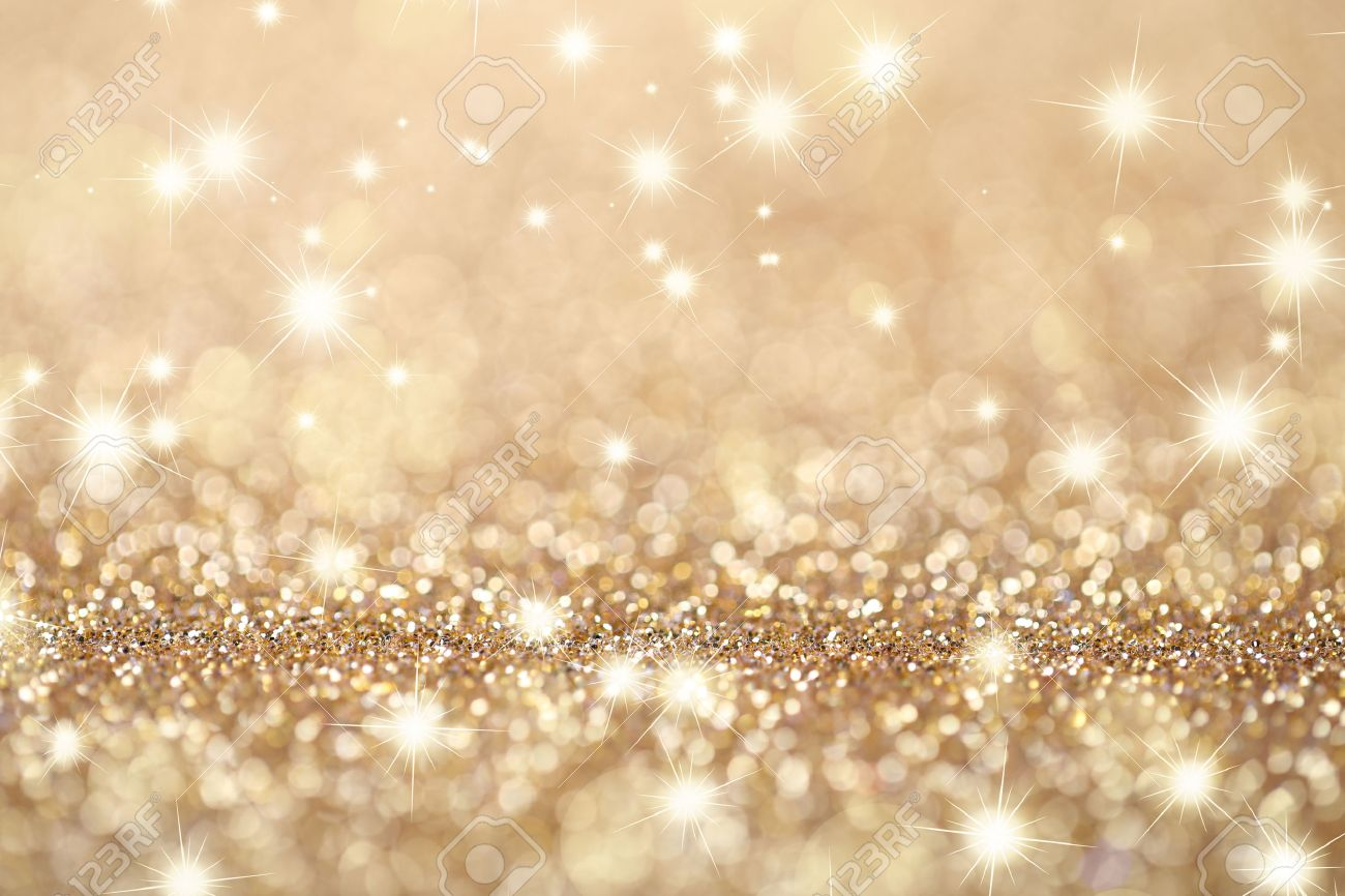 Abstract golden holidays twinkle lights on background. - 50799125