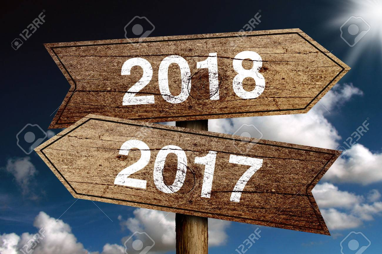 Year 2017 and 2018 road sign with blue sky background. - 62391684