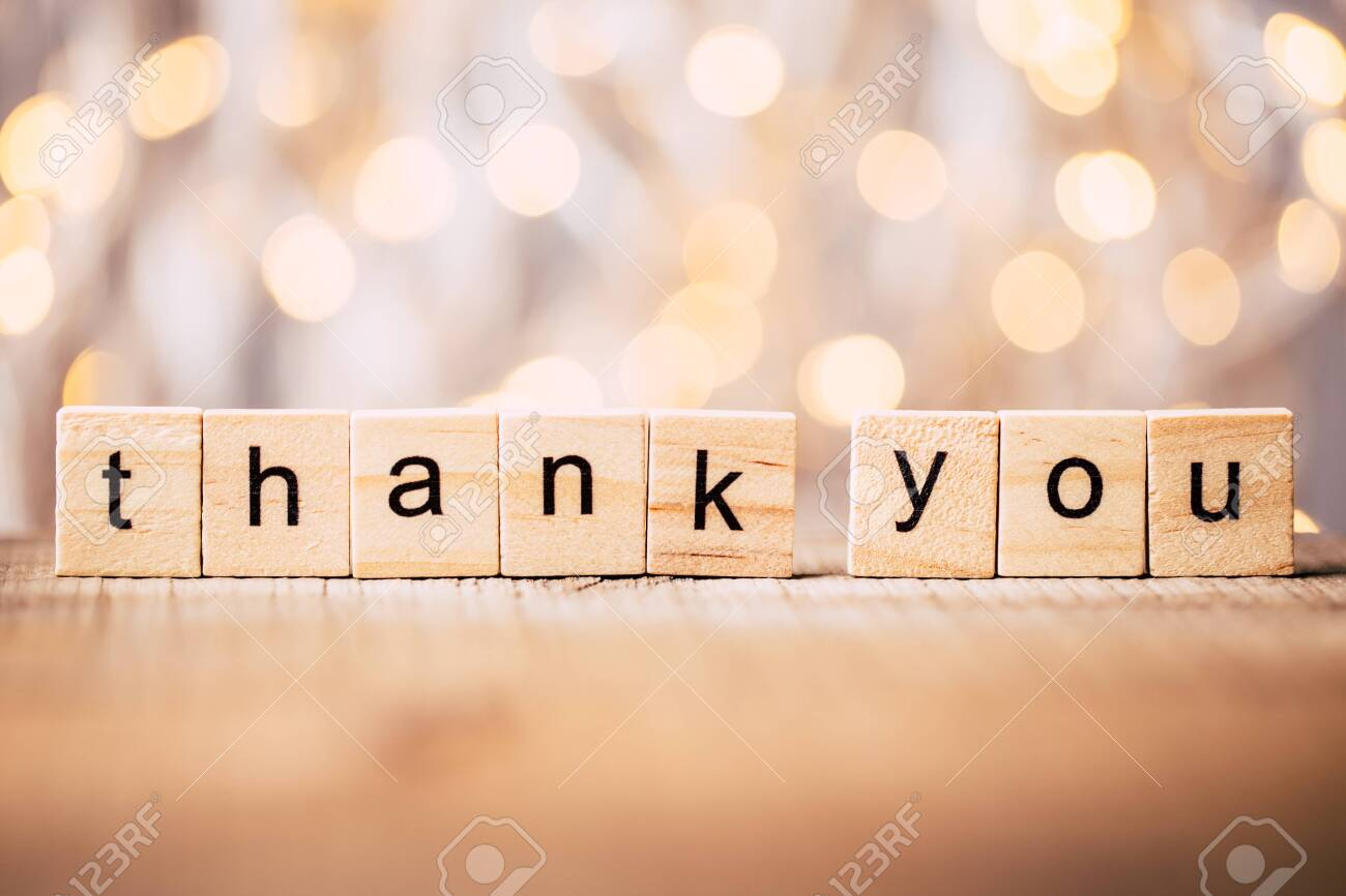Thank you wooden blocks against shiny background. - 124222682