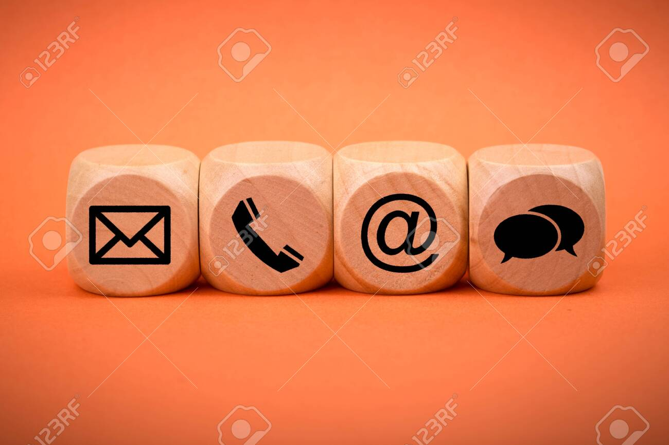 Contact Methods. Close-up of a phone, email, chat and post icons wooden block. - 152379908