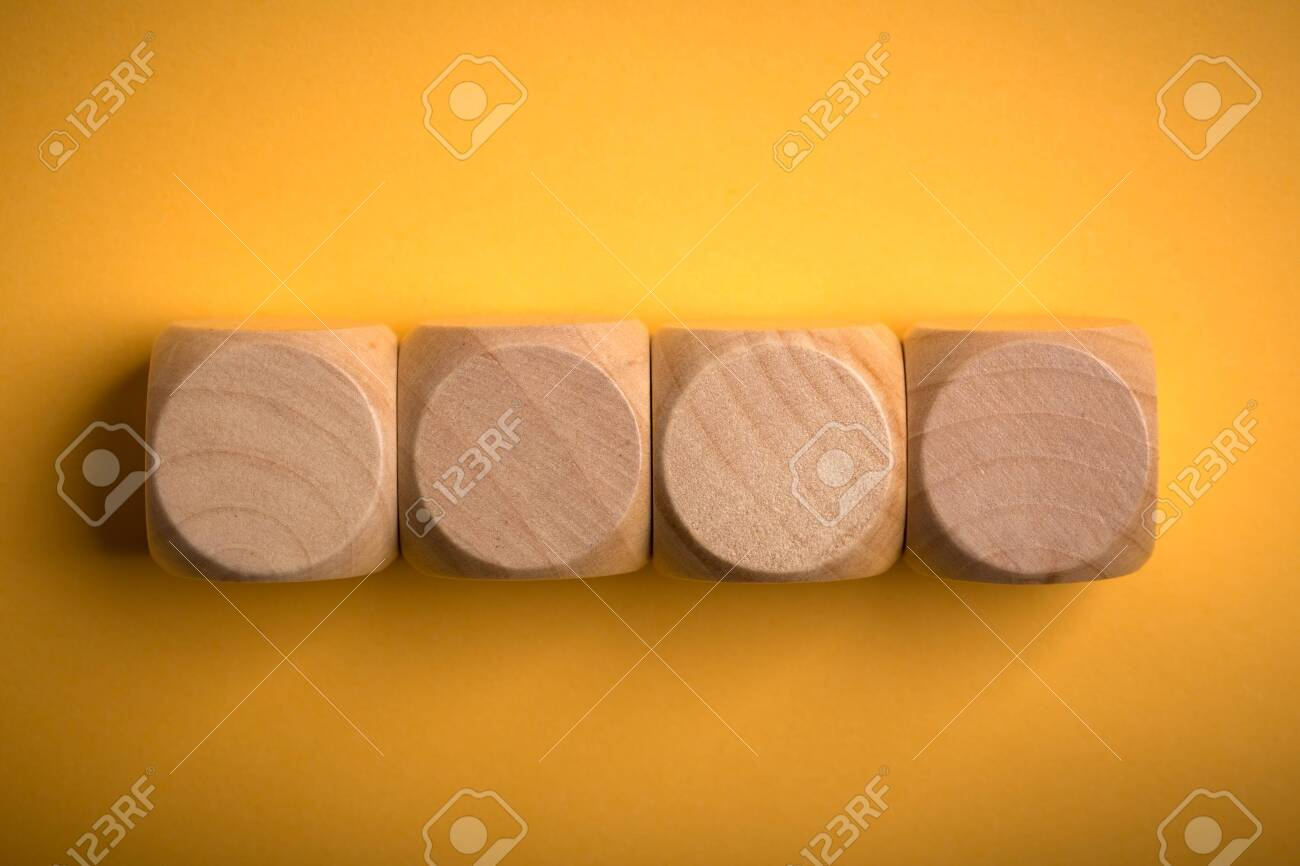 Four blank wooden blocks isolated on color background. - 152380355