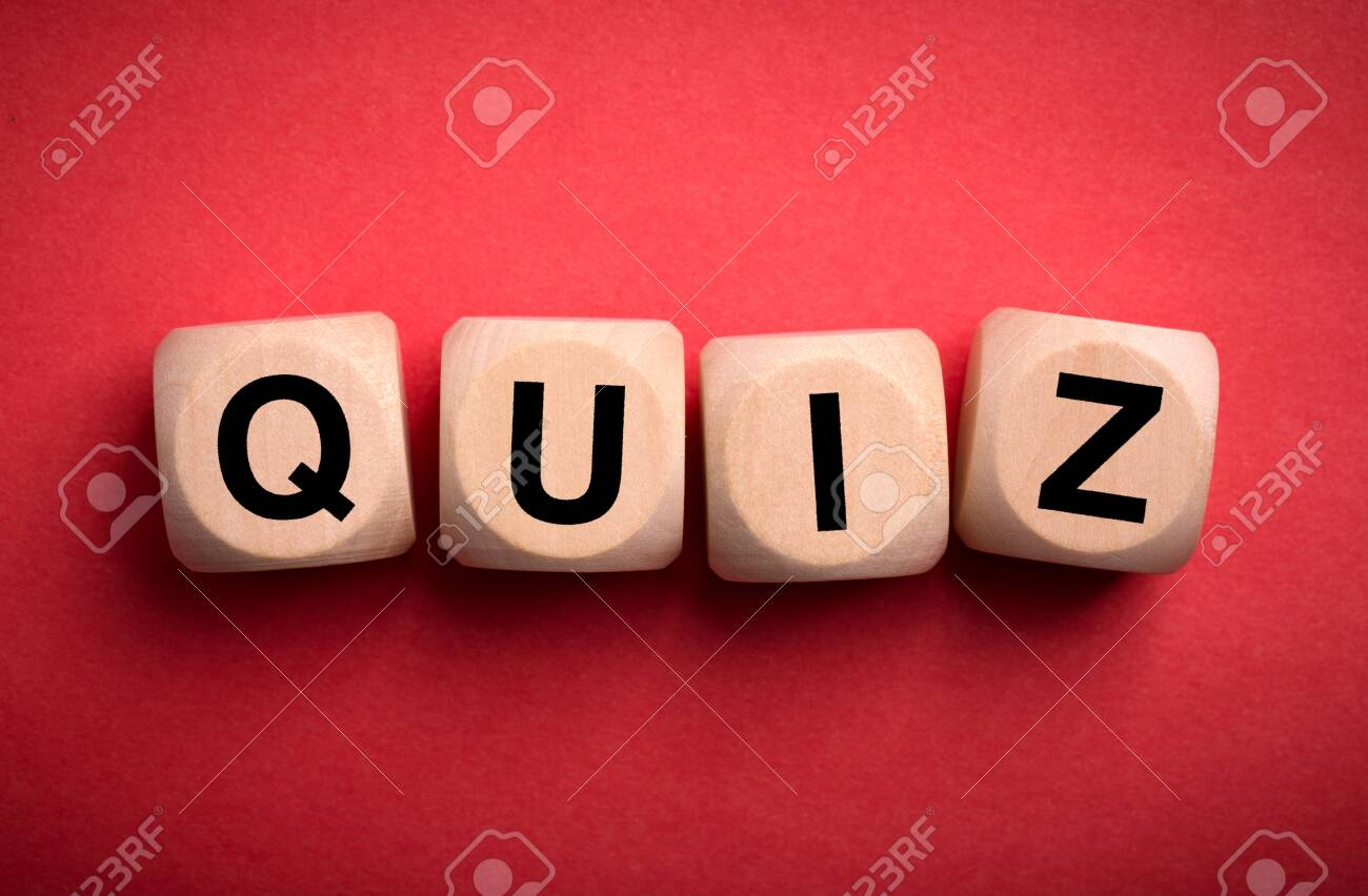 Quiz concept wooden blocks isolated on red background. - 152380353