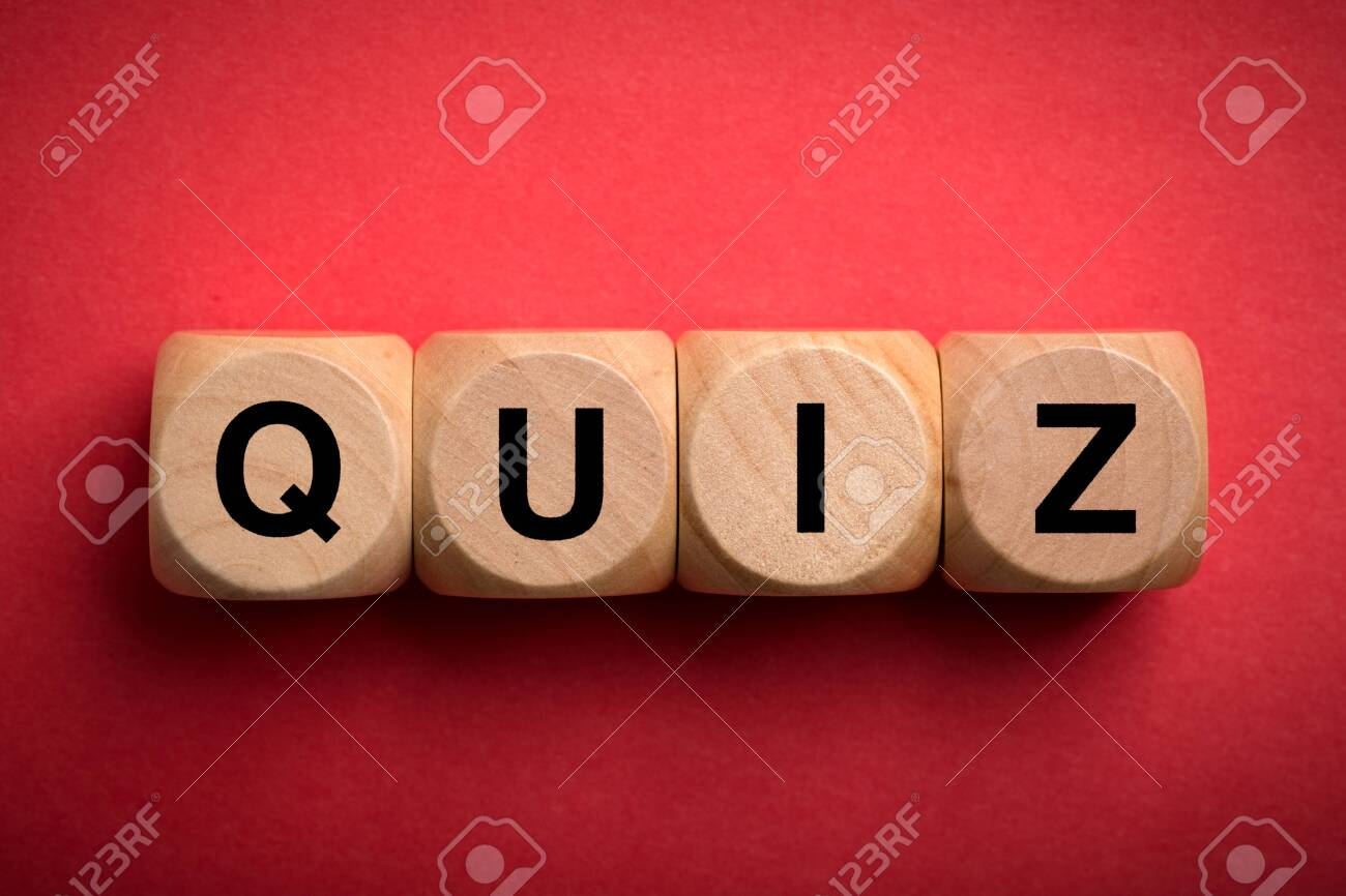 Quiz concept wooden blocks isolated on red background. - 152380521