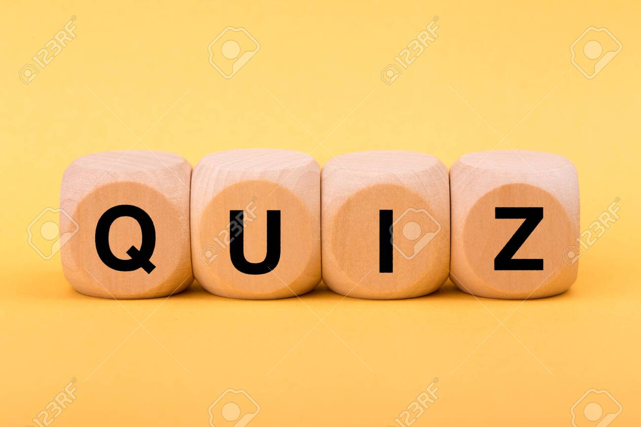 Quiz concept wooden blocks isolated on yellow background. - 152380622