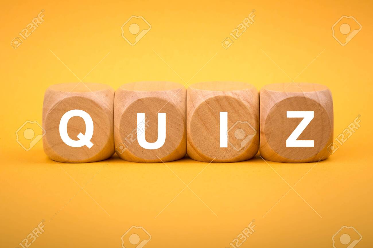Quiz concept wooden blocks isolated on yellow background. - 152380624