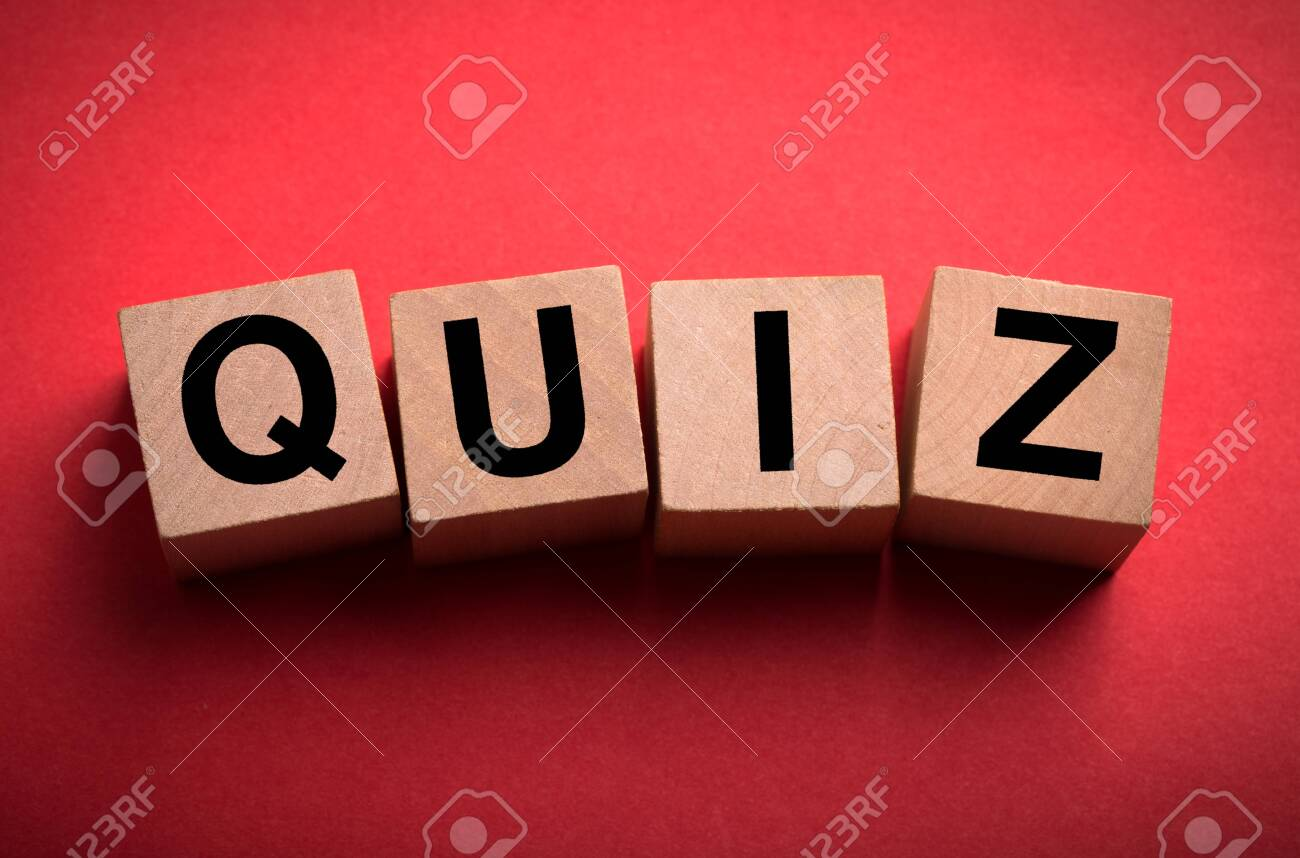 Quiz concept wooden blocks isolated on red background. - 152380633