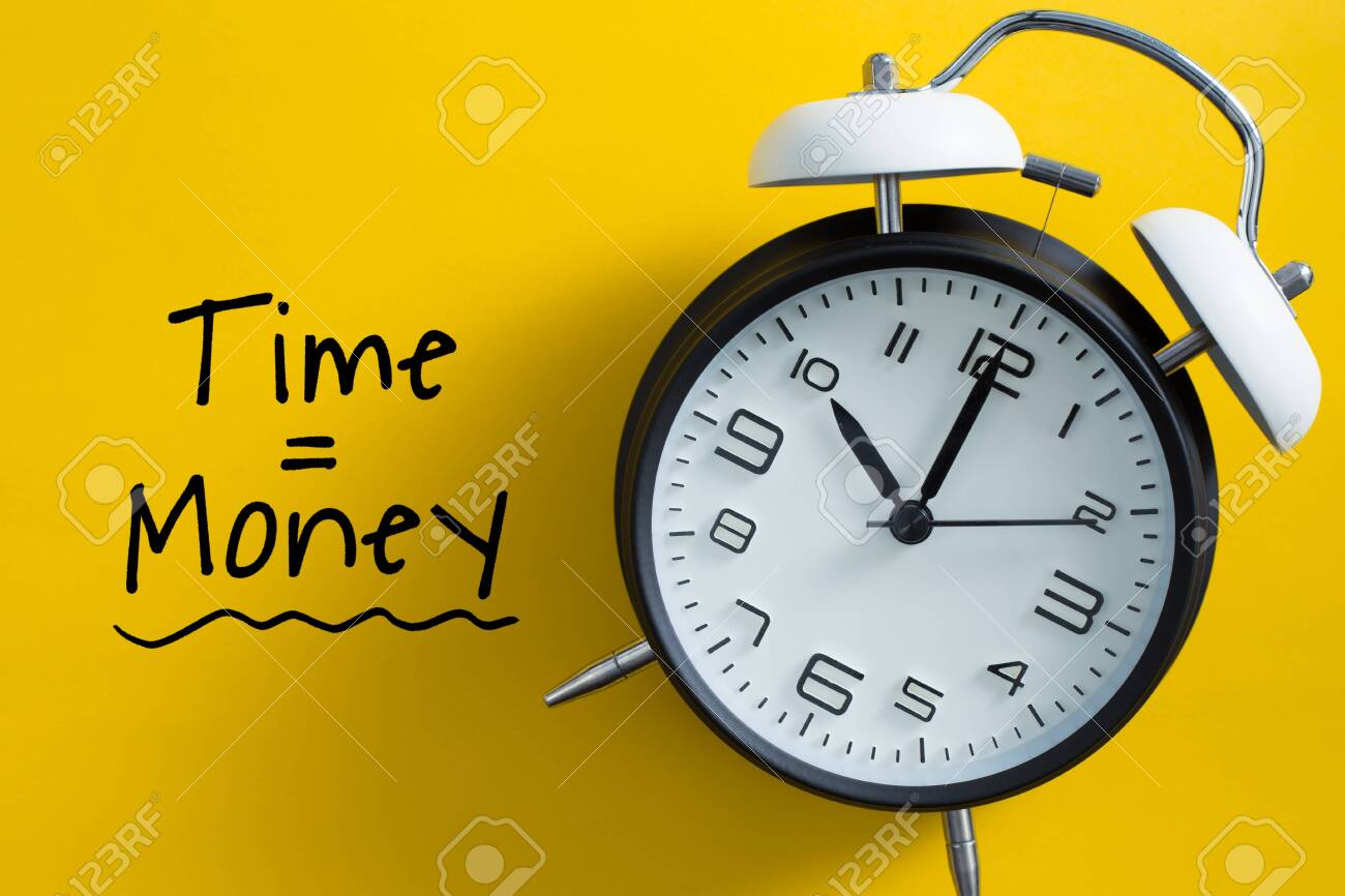 Time is money concept with alarm clock aside. - 152380638