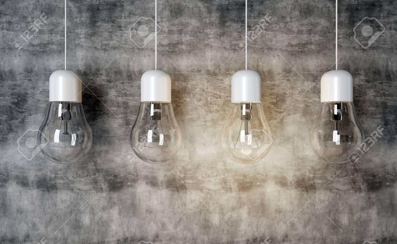 Lampenglühlampen auf konkretem hintergrund lampe beleuchtet