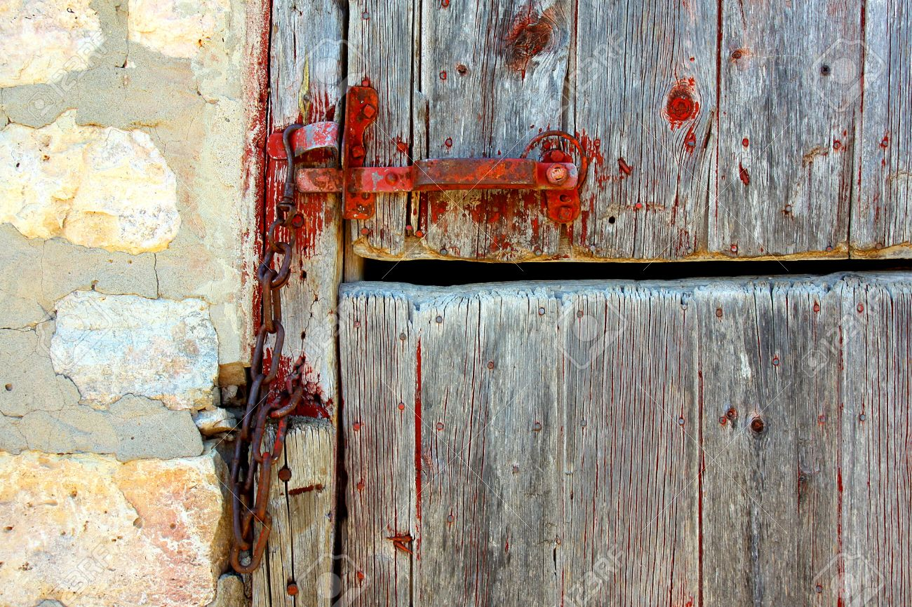 An Zoomed In Crop Of An Old Wooden Barn Door With A Red Latch, Next