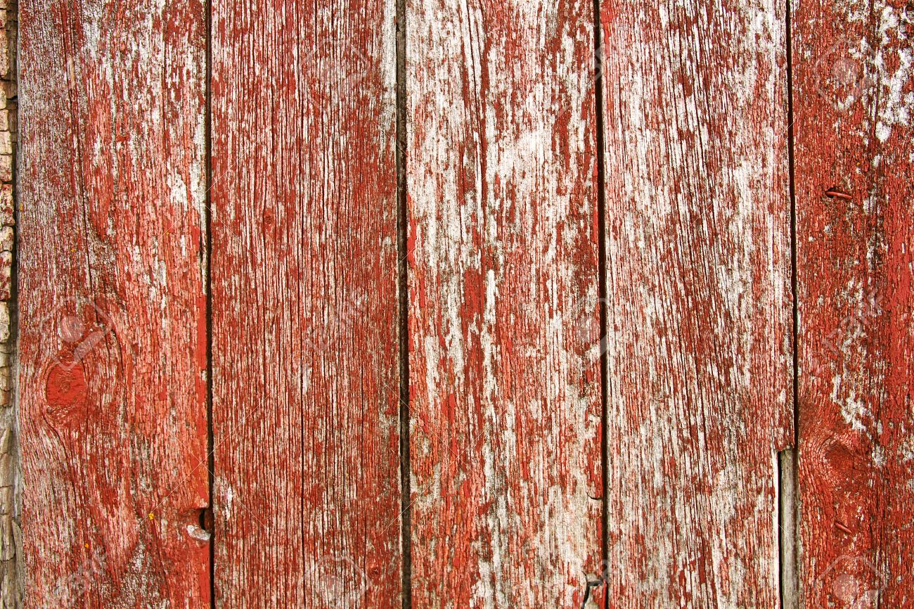 Red Barn Wood a background of old red barnwood with peeling paint on the