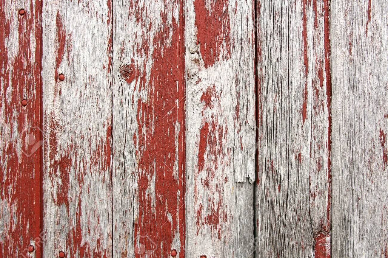 Red Barn Wood a background of rustic, aged barnwood boards, with peeling red