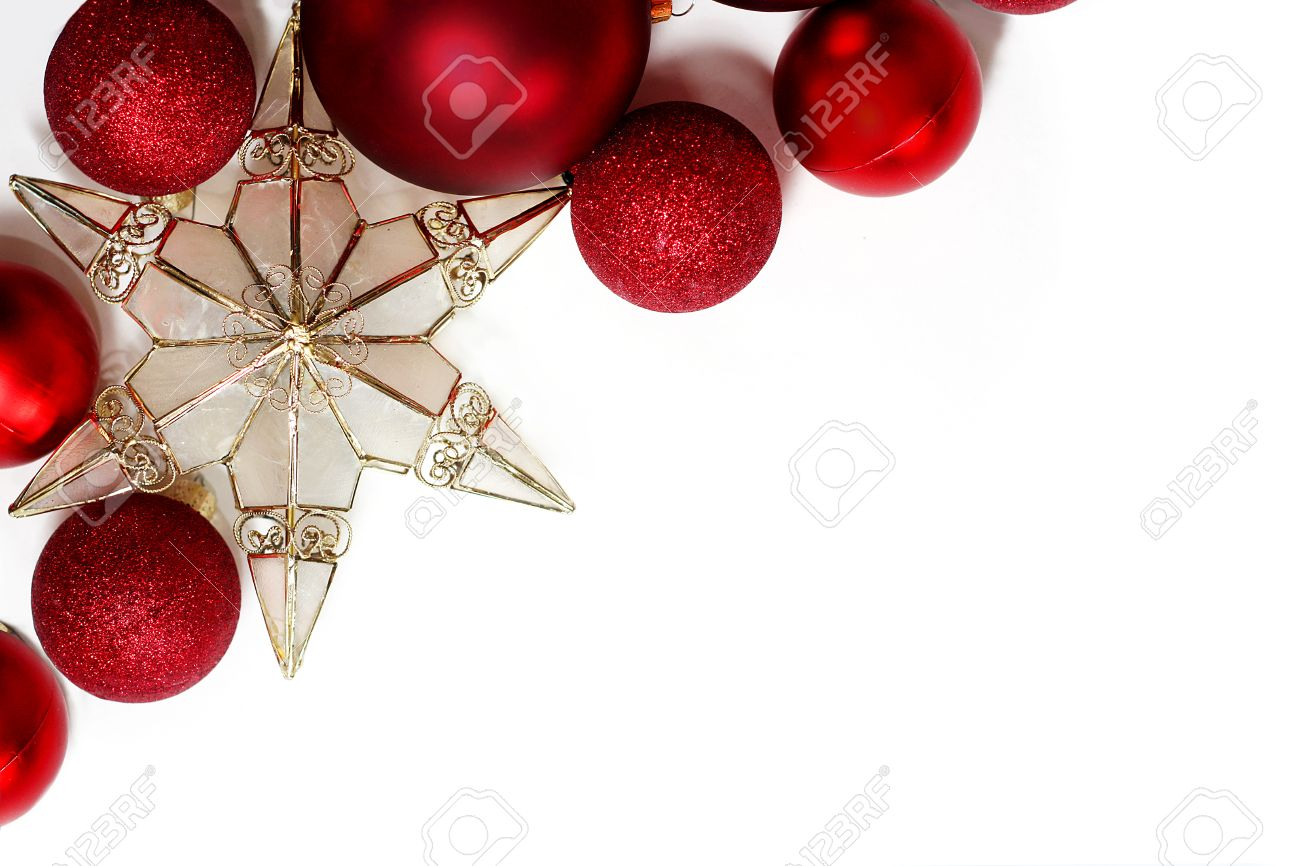 red sparkly christmas bulb decorations and a gold tree topper