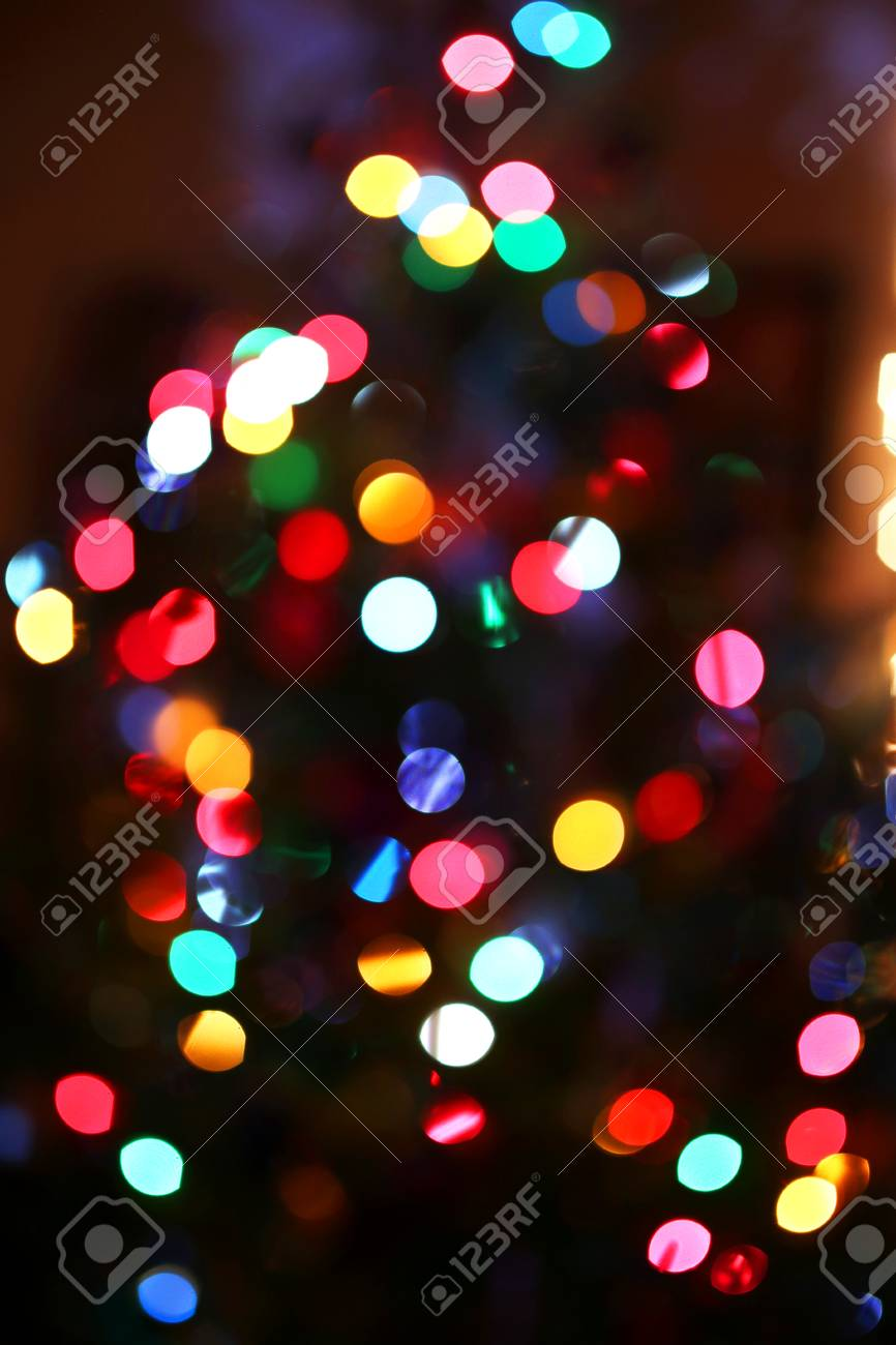 An Abstract Background Of Blurred Rainbow Colored Christmas Tree