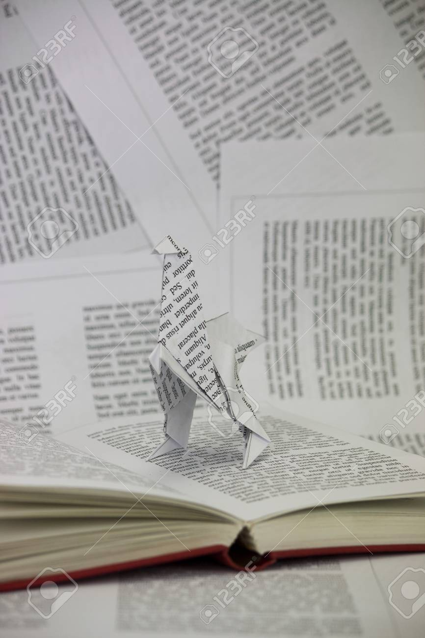 Origami Dinosaur With Words Coming Out Of A Book Lorem Ipsum Text Used Stock