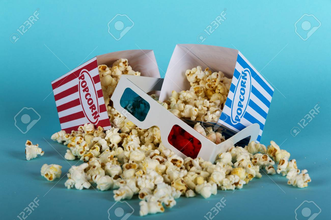 Bucket Of Popcorn Against A Blue Background Stock Photo Picture And Royalty Free Image Image 63447109