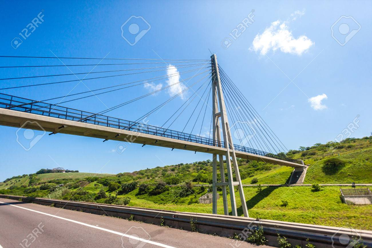 Pedestrian public cable suspended bridge crossing over highway
