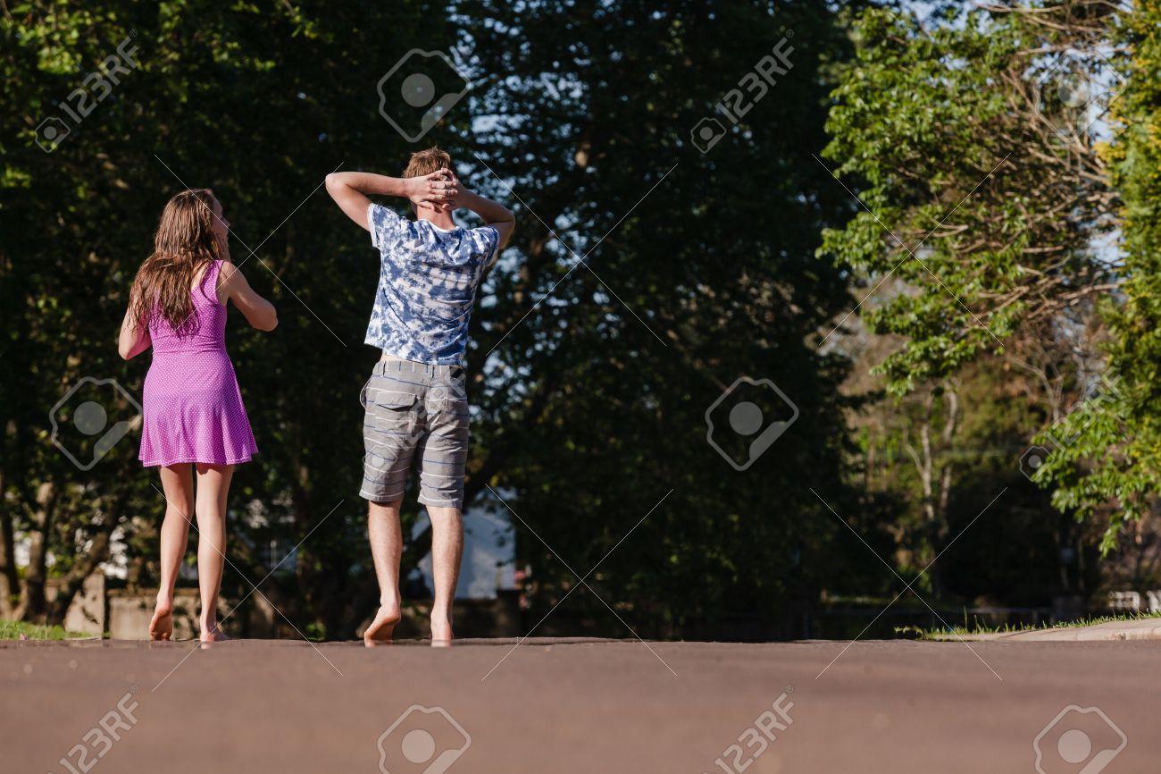 A Boy Walking Away From A Girl Stock Photo - Teen girl boy
