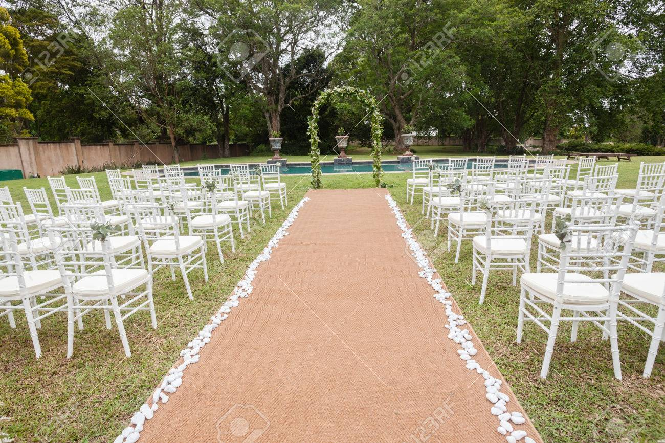 Stock Photo   Wedding Decor Chairs Ceremony Lawn Pool Landscape With Guests  Lunch Dinner Table Settings On Porch Verandag