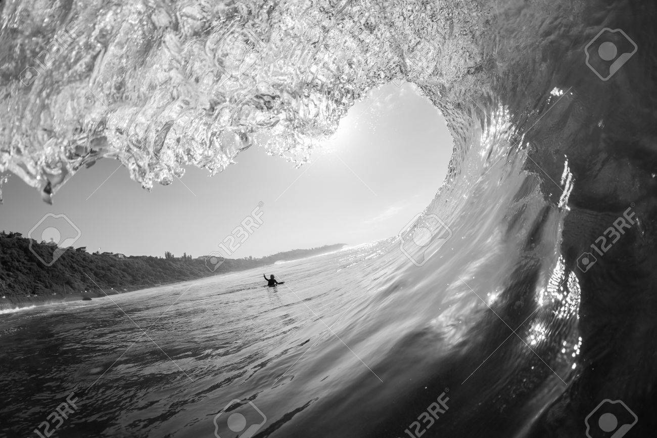 Wave surfer tube ride view swimming inside out water ocean black