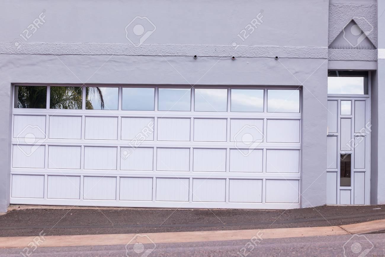 Ordinaire Double Garage Door And Pedestrian Door Cream Grey Reflective Decor Colors  Road Entrance Stock Photo