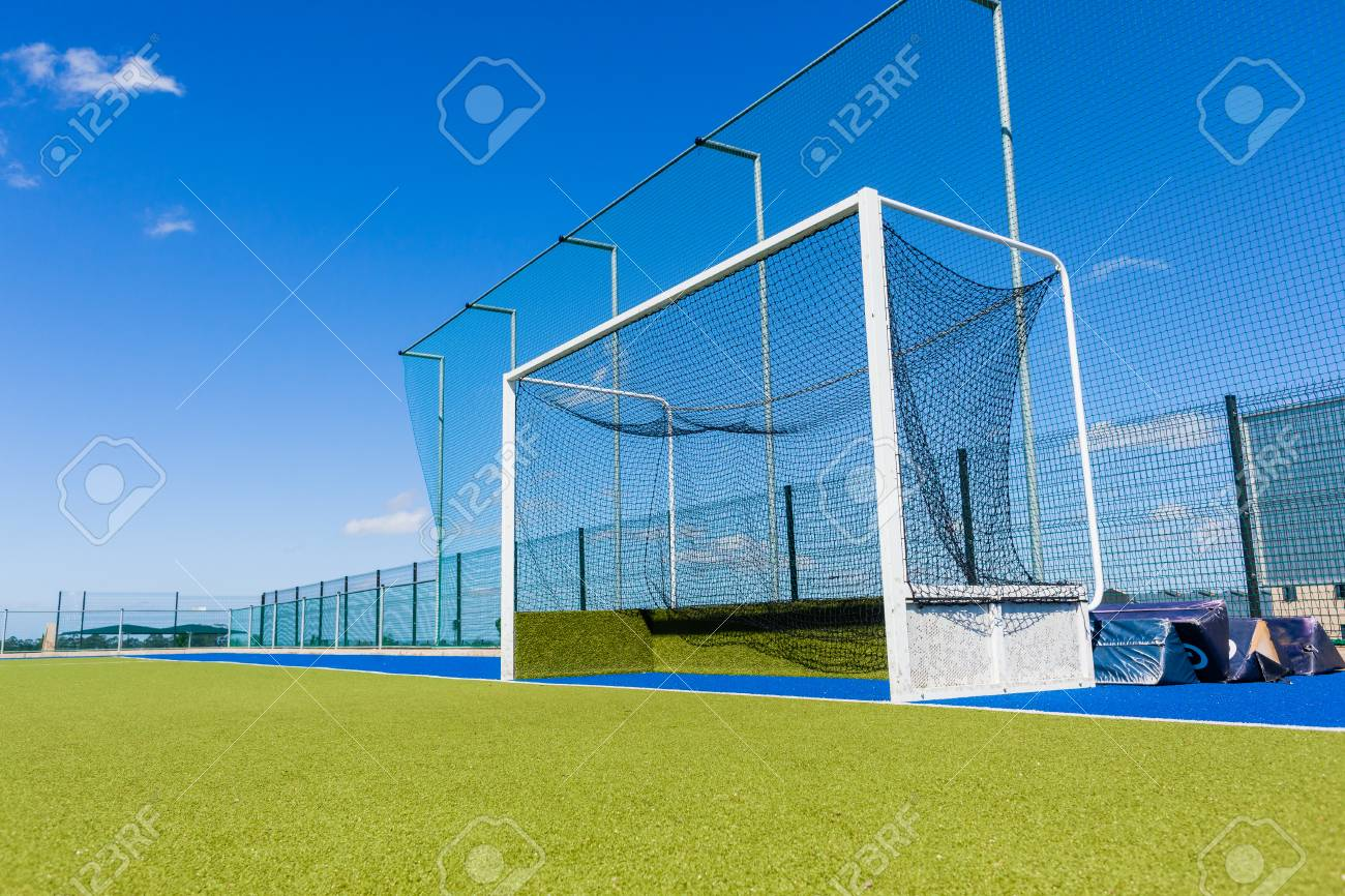 Hockey field goals nets astro turf surface field outdoors countryside. - 88176280