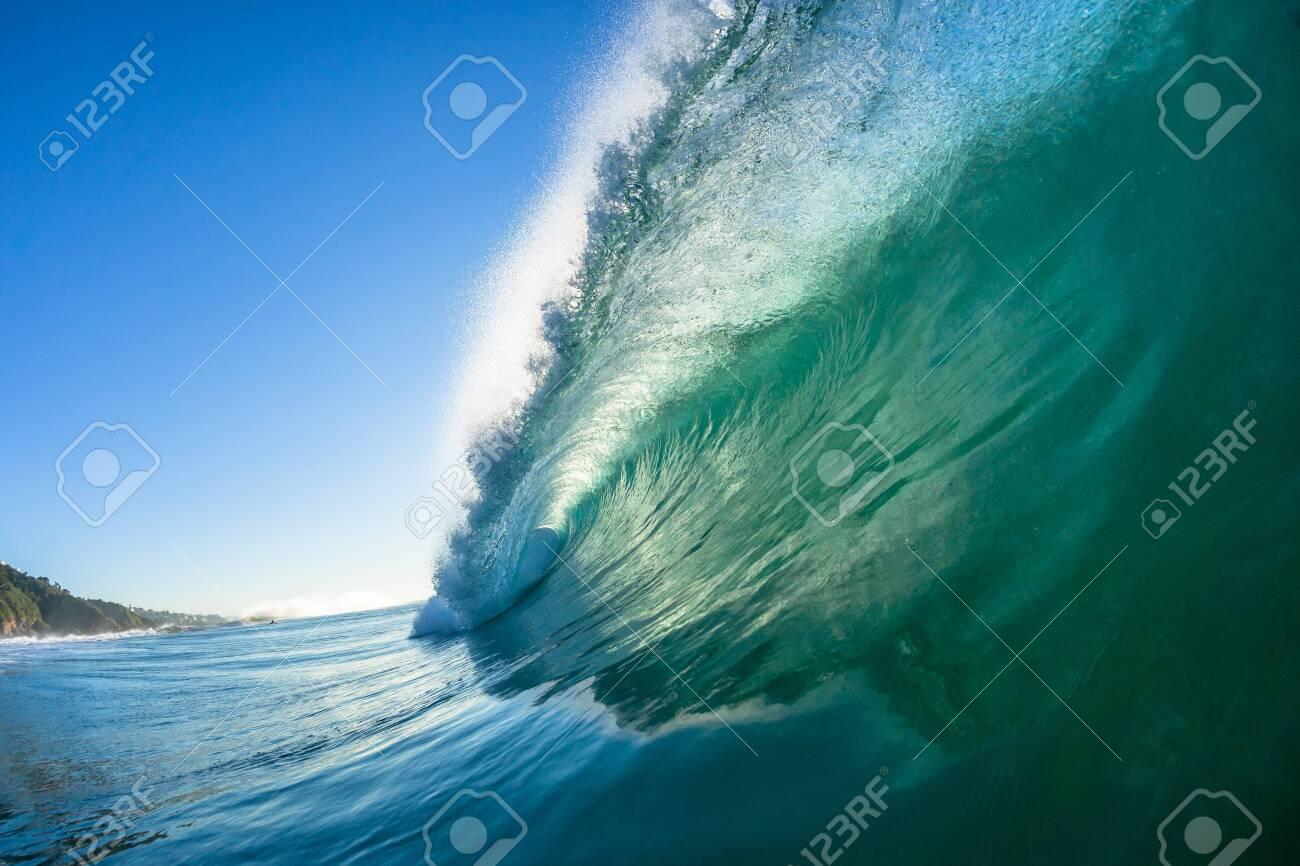 Ocean swimming closeup inside hollow crashing wave water towards camera lens. - 126288977