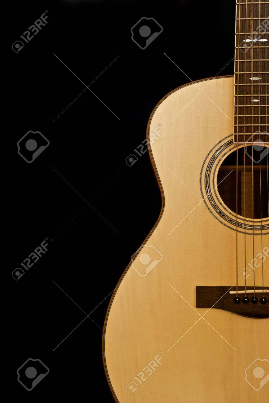 Acoustic Guitar Shown Against A Black Background Stock Photo