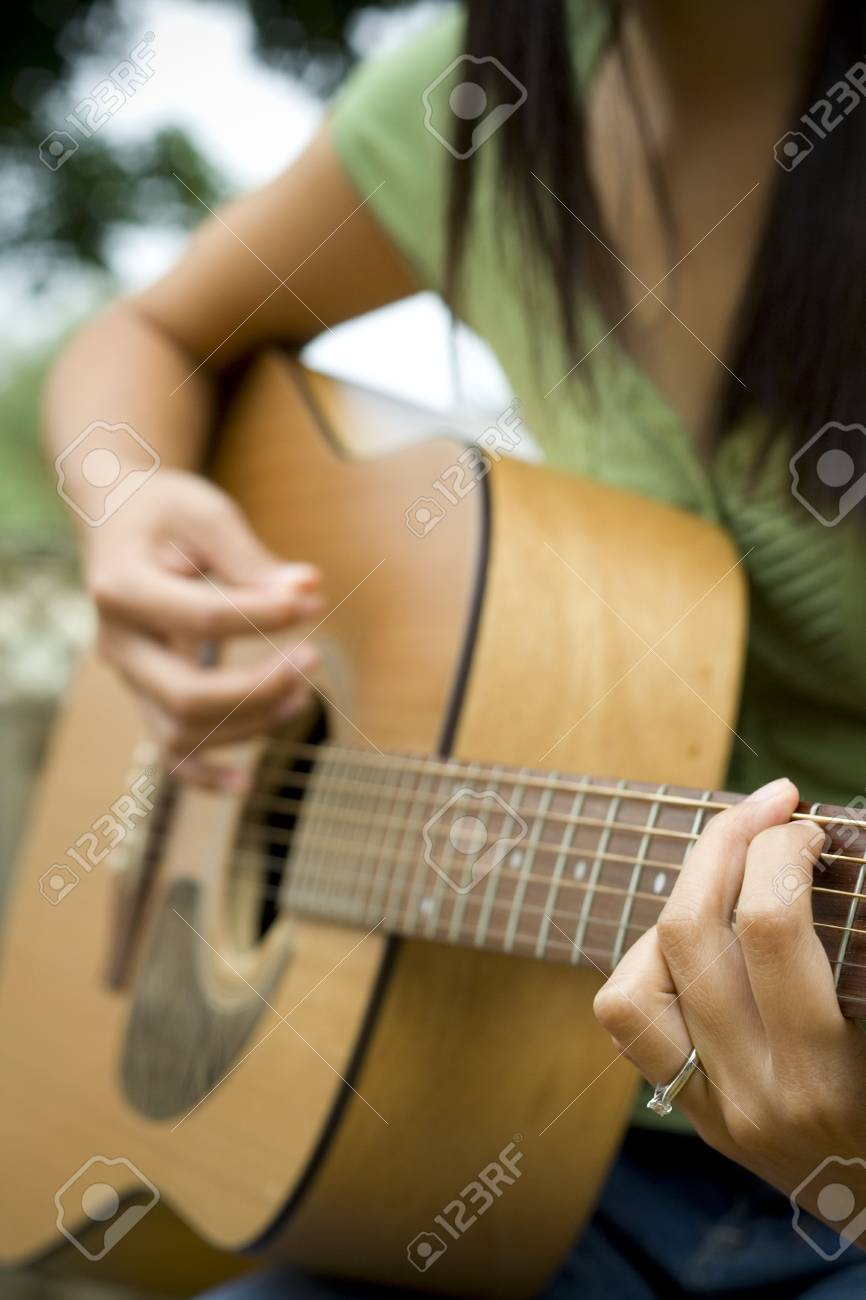Young Woman Playing Guitar Stock Photo - 3563468