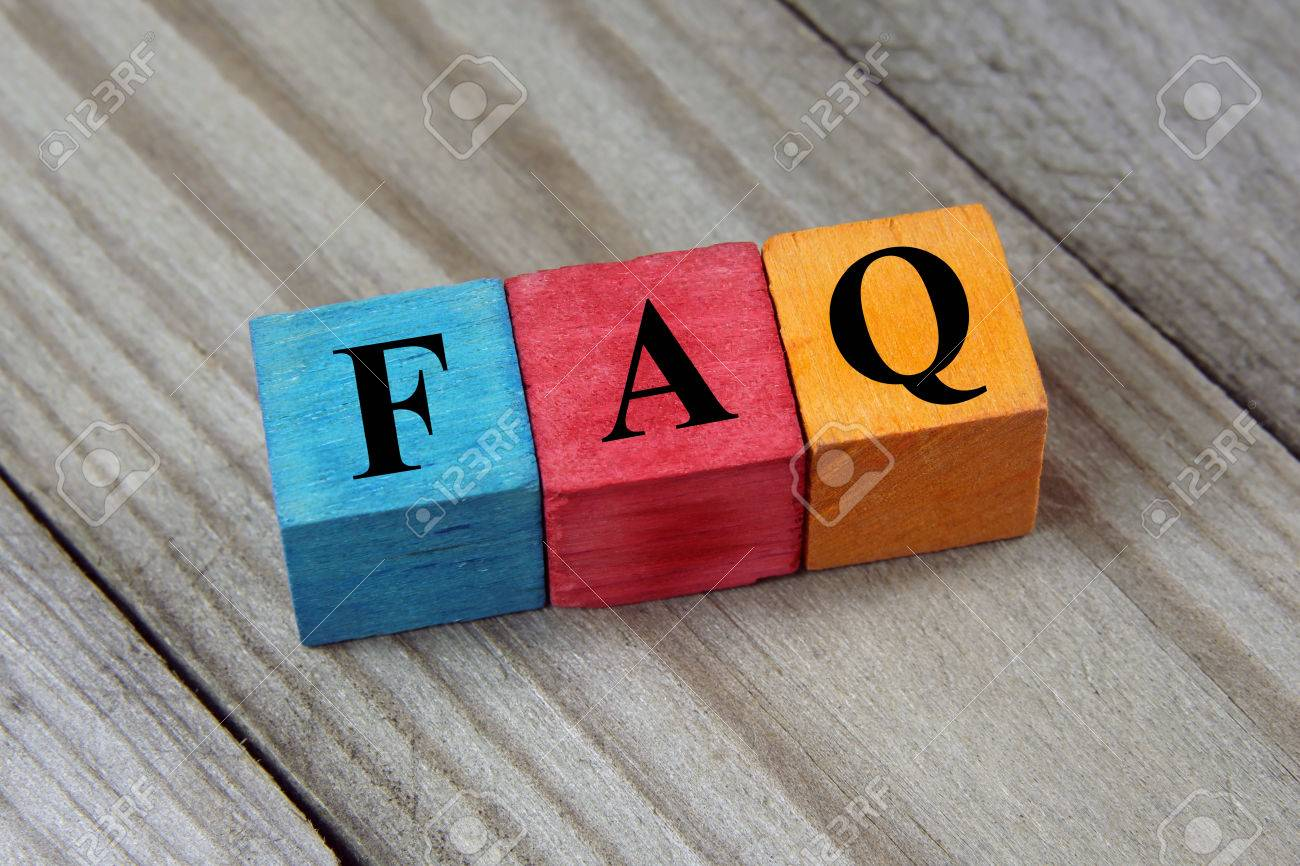 Concept of FAQ word on wooden colorful cubes - 30909228
