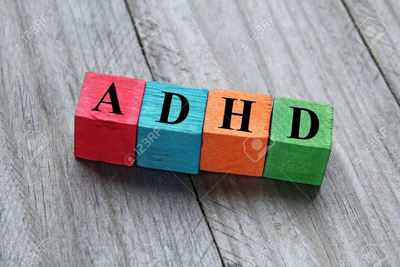 concept of adhd word on wooden colorful cubes - 34533530