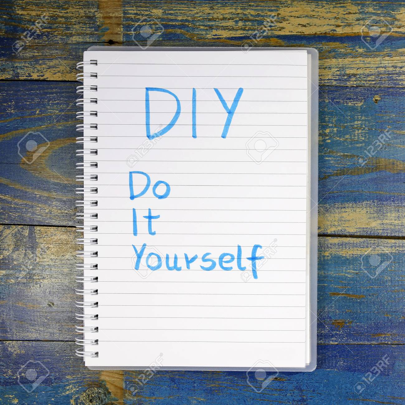 Diy do it yourself written in a notebook on wooden background stock diy do it yourself written in a notebook on wooden background stock photo 63626477 solutioingenieria Images