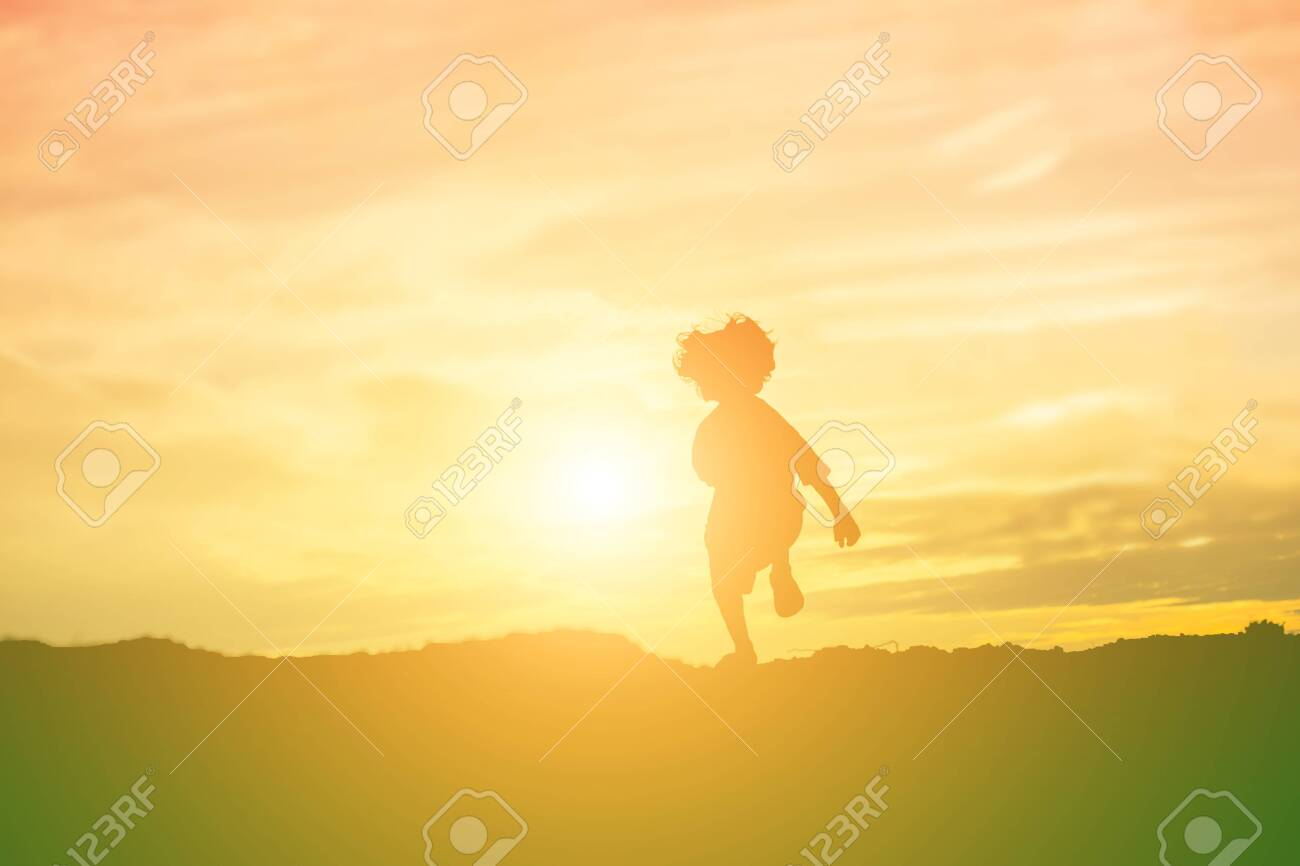 kid silhouette,Moments of the child's joy. On the Nature sunset - 134080189