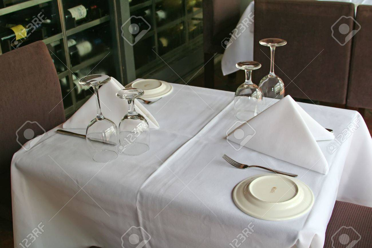 Fine Dining Table Setting With View Of Wine Bottles In The ...