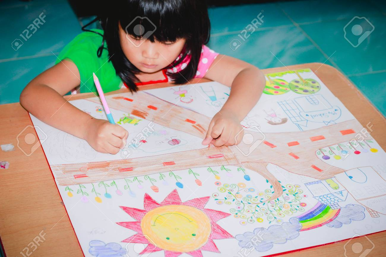 Cute Asian Girl Is Painting And Painting House And Garden Picture